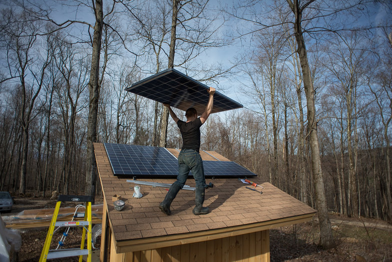Tyler Carrying Solar Panel