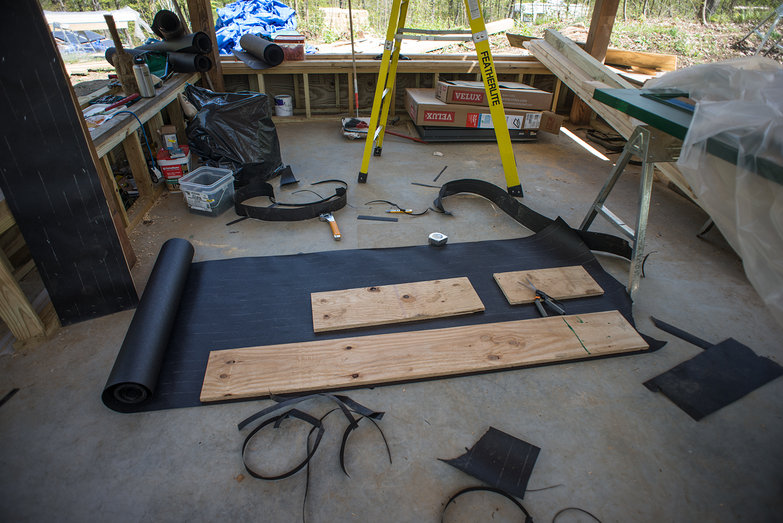 Covering Plywood with Tar Paper for Plaster Breaks