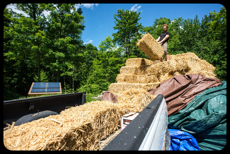 Tyler Loading Straw Bales into the Truck