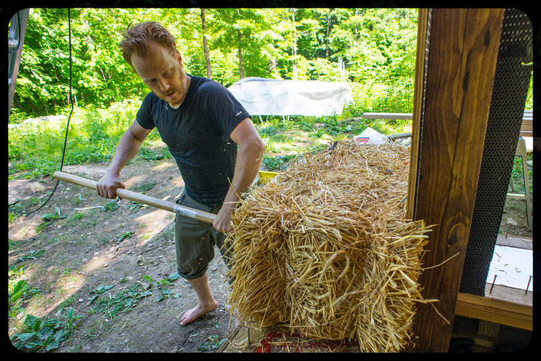 Tyler Tamping the First Bale into Place
