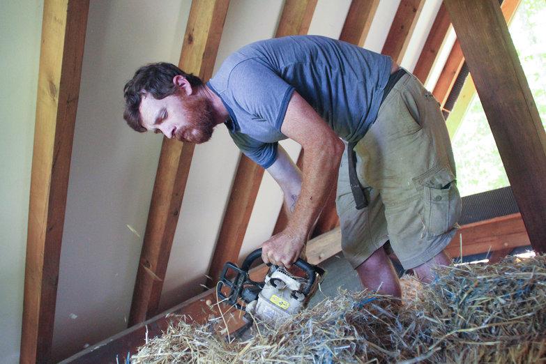 Pete Chainsawing Bale (by Natasha)
