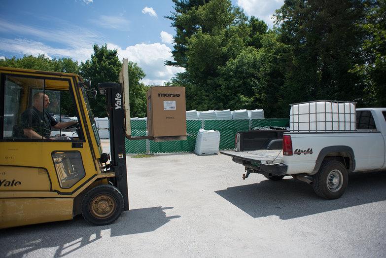 Forklift Loading Morso Woodstove into Truck