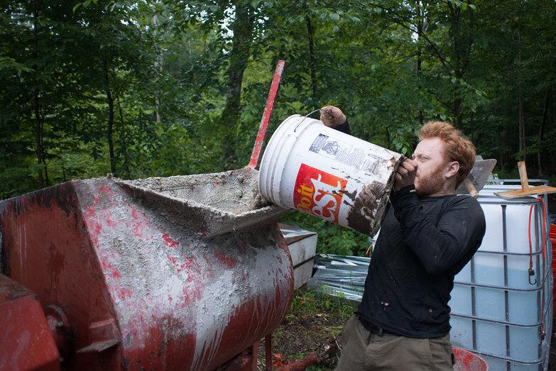 Tyler Pouring Sand into Mortar Mixer