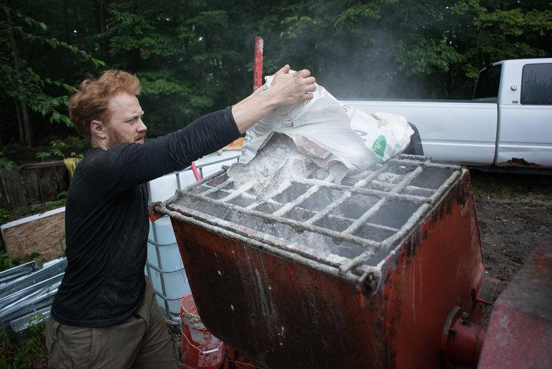 Tyler Putting Lime into Mortar Mixer