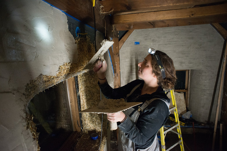 Tara Plastering Interior of Straw Bale Cottage
