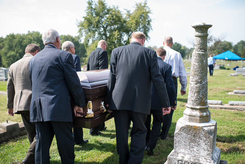 Pallbearers Carry Casket
