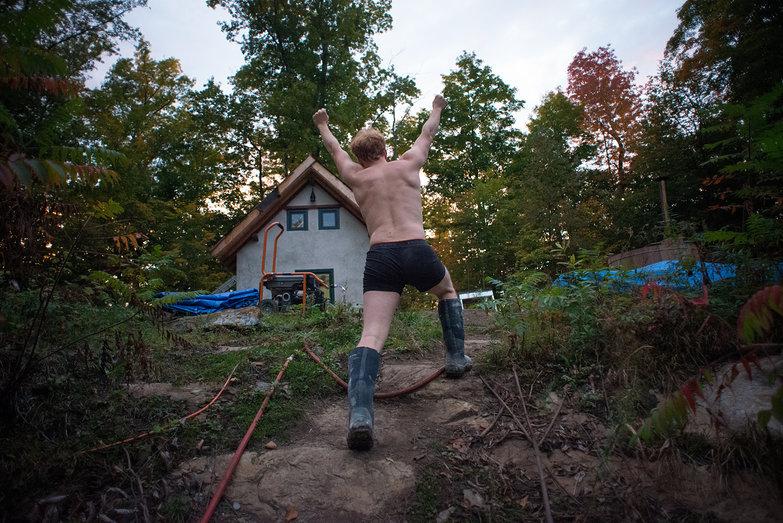 Triumphant Tyler in his Undies & Boots Climbing Rock Ridge Towards House