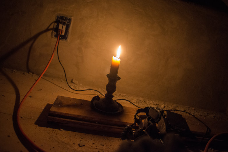 Candle In Unfinished Cottage Loft