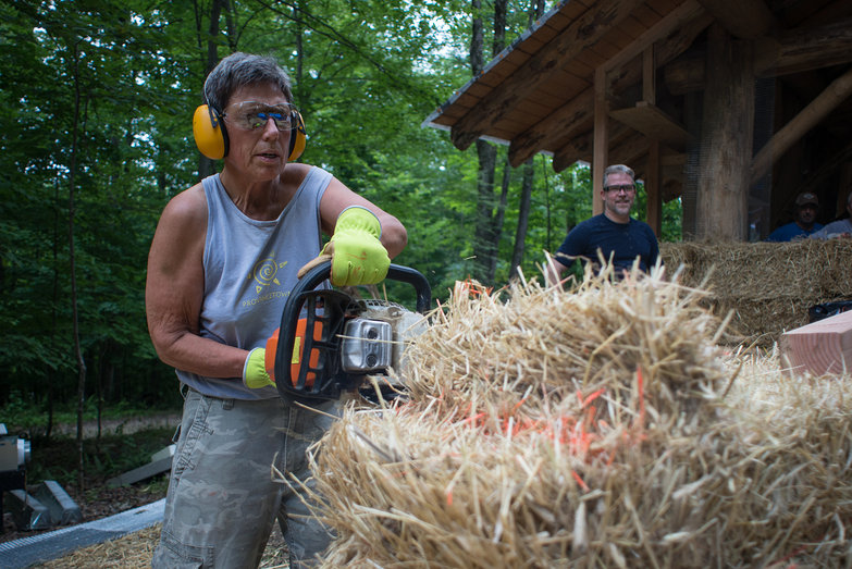 Carol Notching Strawbale w/ Chainsaw