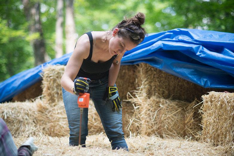 Sarah Measuring Strawbale Moisture