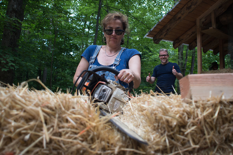 Emily Notching Strawbale w/ Chainsaw