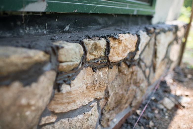 Strawbale Cottage Stonework Ponywall in Progress
