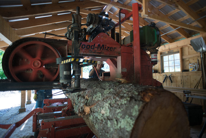 Dave Cutting Pine Live Edge Siding on Wood Mizer