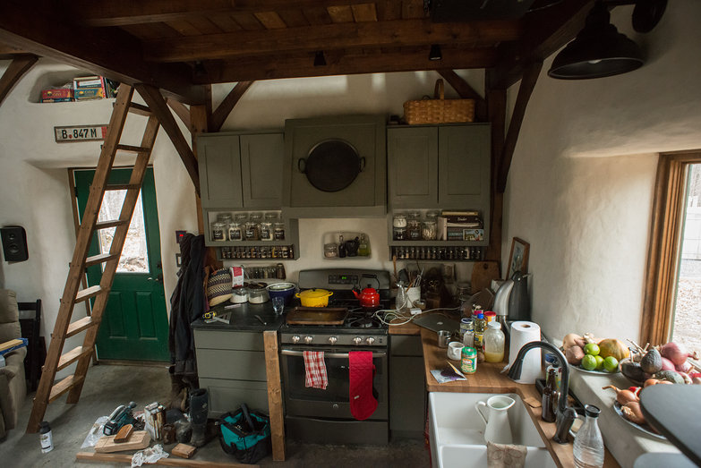 Messy Straw Bale Cottage Kitchen with Loft Ladder (Construction Zone!)
