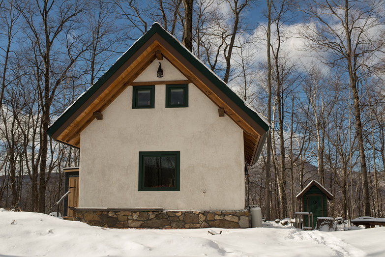 Our Straw Bale Cottage & Outhouse in the Snow