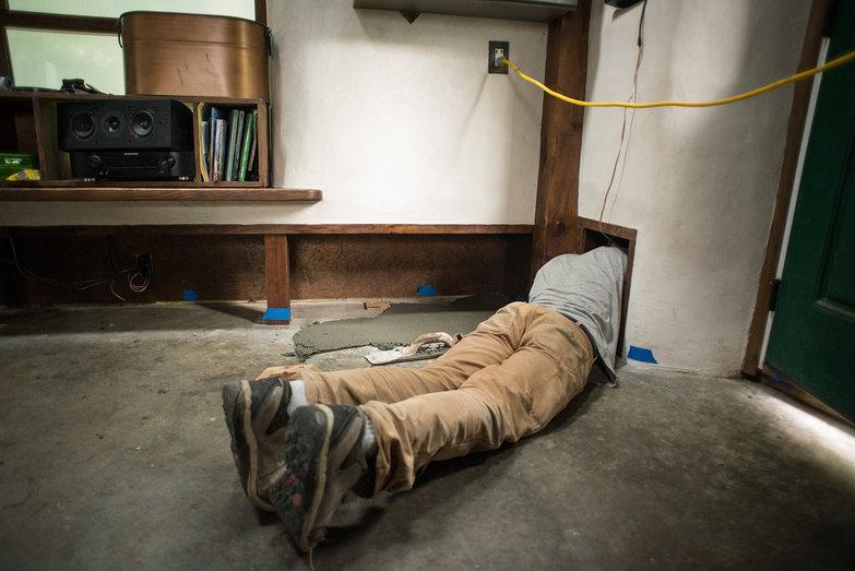 Chad Applying First Layer of Earthen Floor in Speaker Nook