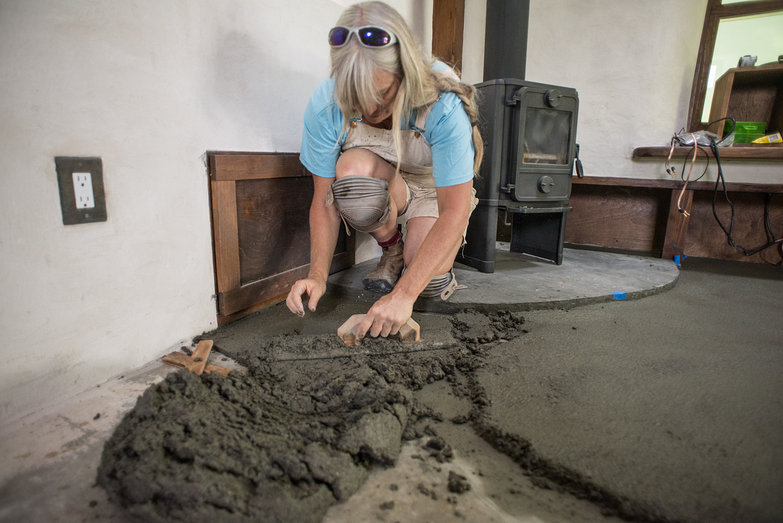 Liz Applying First Layer of Earthen Floor