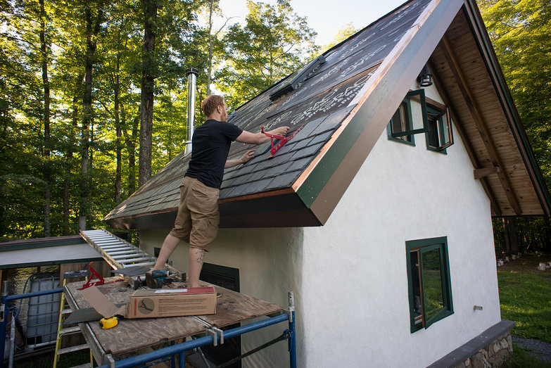 Tyler Installing Slate on Strawbale Cottage Roof