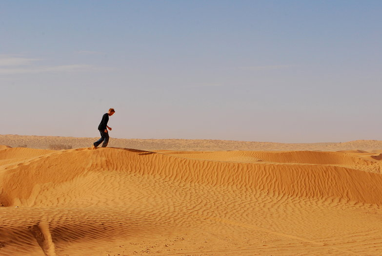 Tyler Running on a Sand Dune