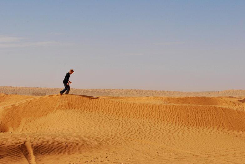 Tyler Running on a Sand Dune