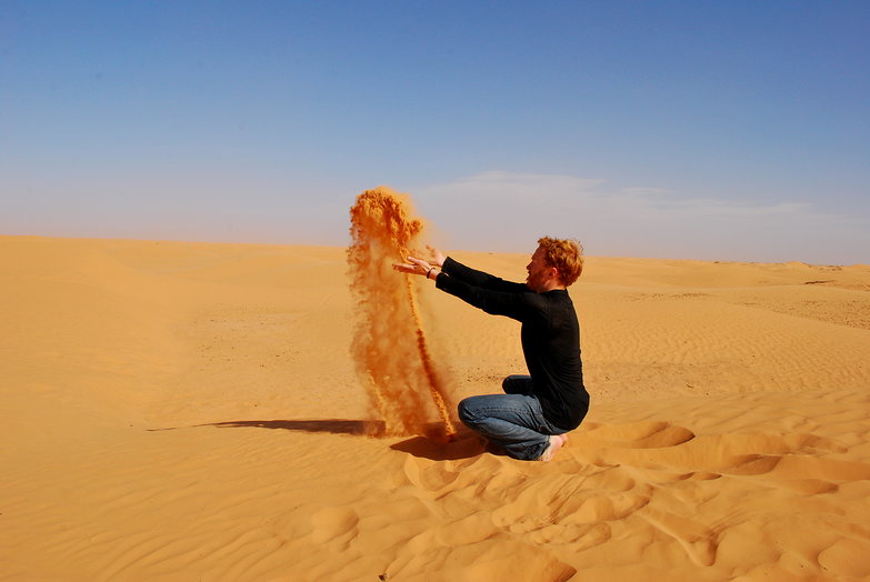 Tyler Throwing Sand