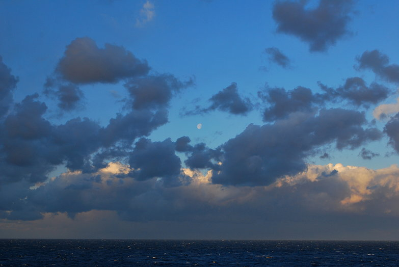 Moon & Clouds Over Ocean