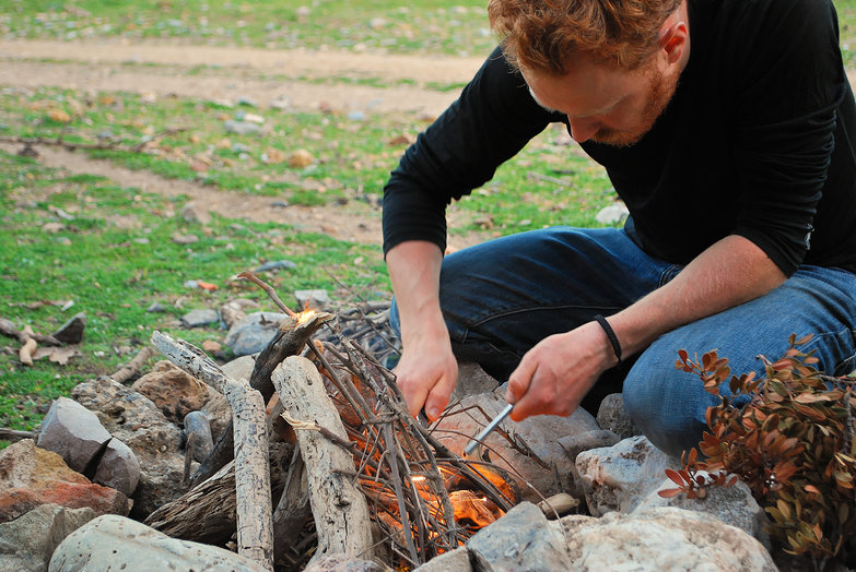 Tyler Making a Fire w/ Flint & Steel