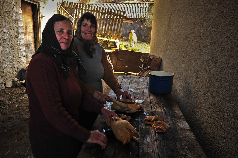 Romanian Women Preparing Chickens