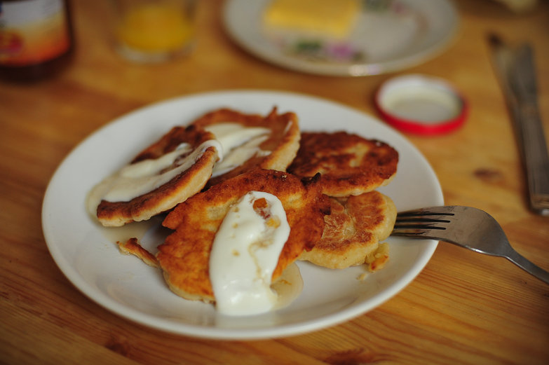Syrniki with Sour Cream and Apricot Syrup
