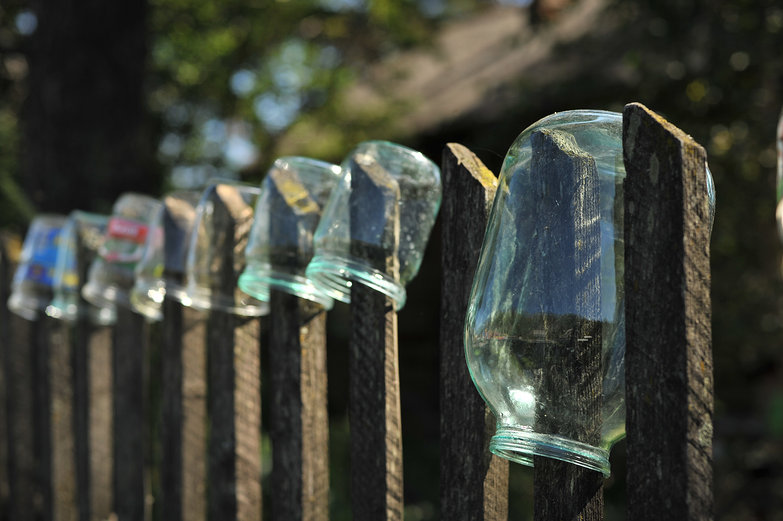 Glass Jars Drying on Fence