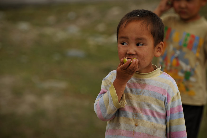 Russian Altay Kid Eating Apple