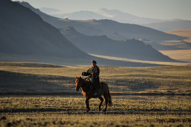 Mongolian Man on Horseback