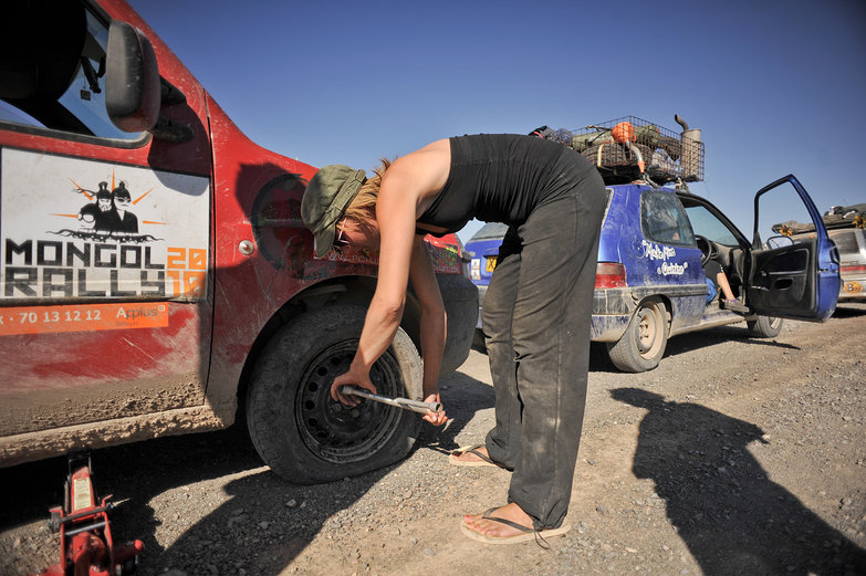 Mette Changing Flat Tire