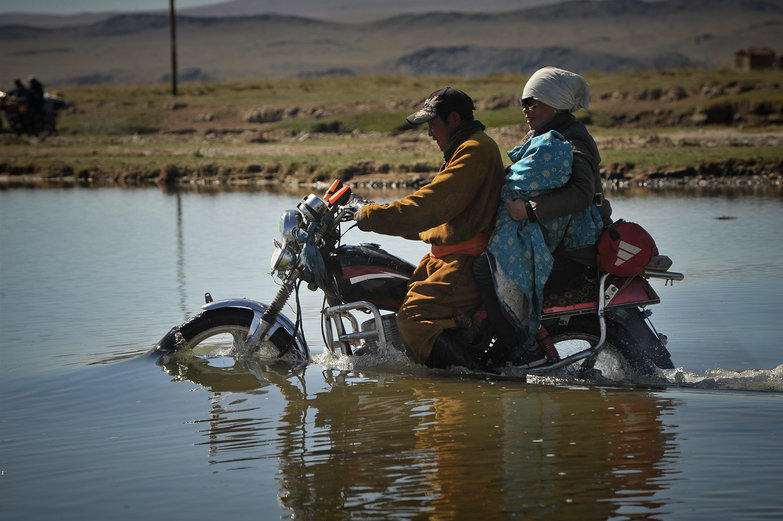 Mongolian Family River Crossing