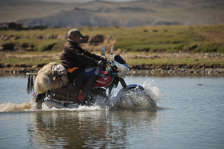 Mongolian Motorcyclist River Crossing