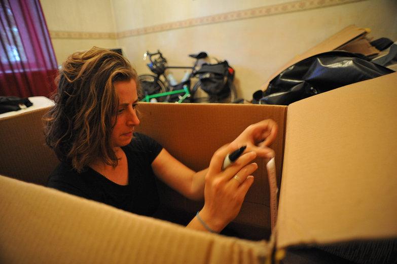 Tara Measuring the Cardboard Box