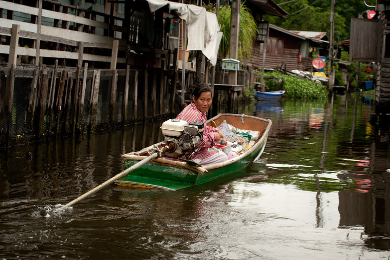 Woman Boating Along the Klong