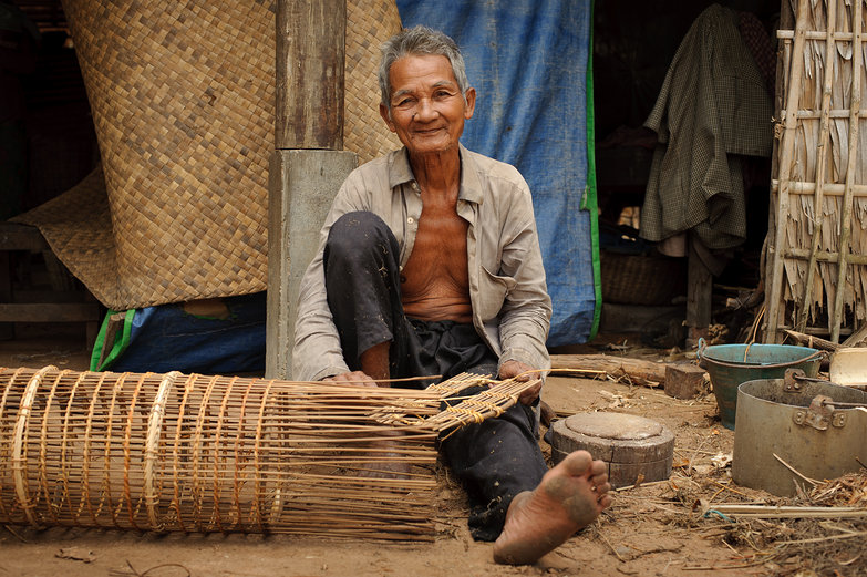 Old Cambodian Man Weaving Baskets