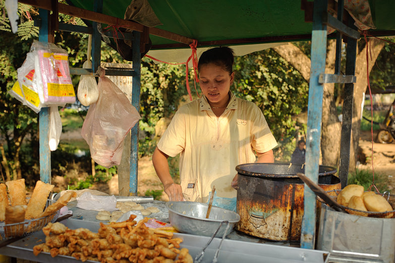 Cambodian Woman Making Fried Pastries