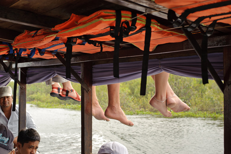 Feet Dangling from Upper Deck