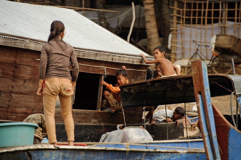 Cambodian Kids Climbing on Boat