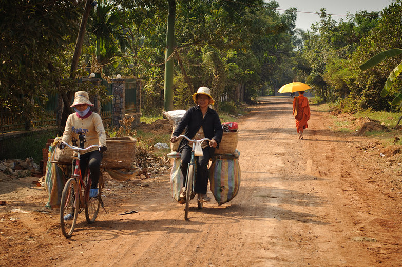 Cambodian Cyclists & Monk on Dirt Road