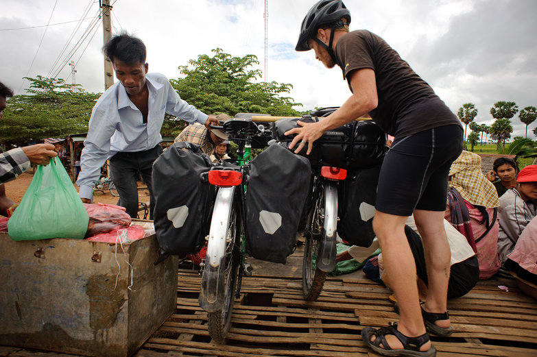 Tyler Loading Our Bikes onto Bamboo Railway