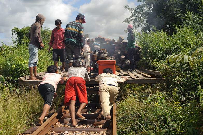 Pushing Cambodian Bamboo Railway Car