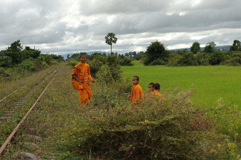 Monks Waiting to Board Bamboo Railway
