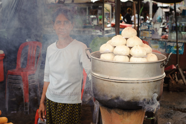 Cambodian Woman & Steaming Buns