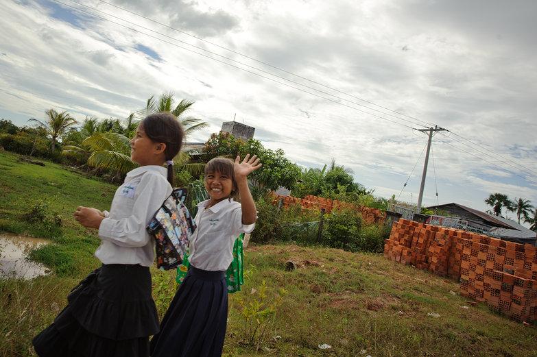 Cambodian Schoolgirls Waving Hello