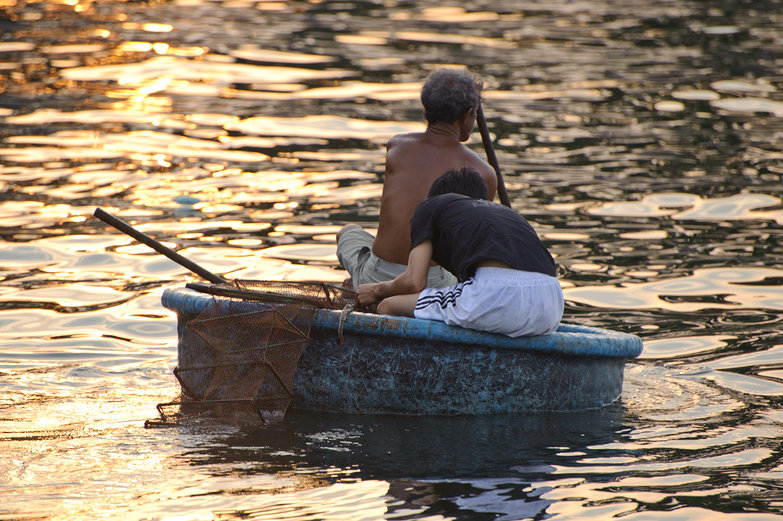 Fishermen in Round Basket Boat