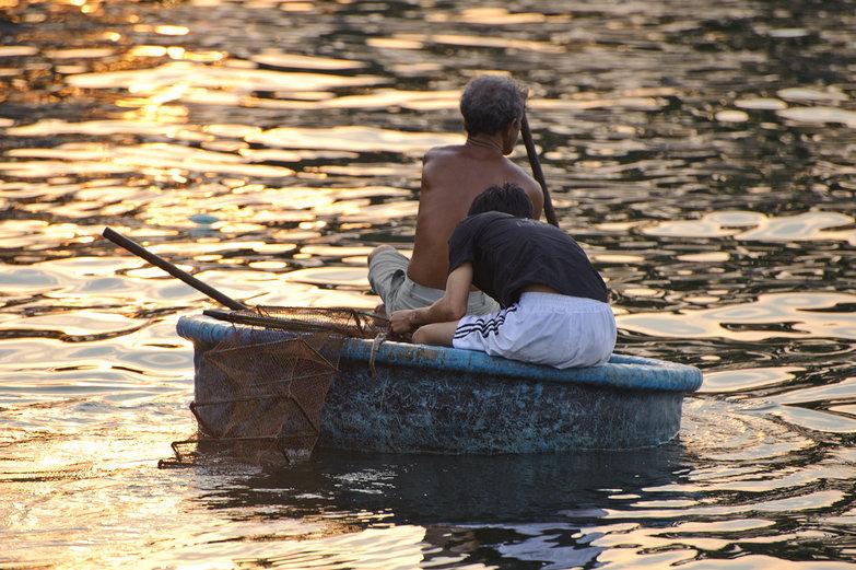 Fishermen in Round Basket Boat