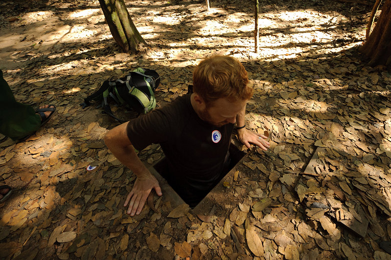 Tyler Entering Cu Chi Tunnels